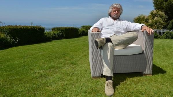 Italian comedian Beppe Grillo poses duri