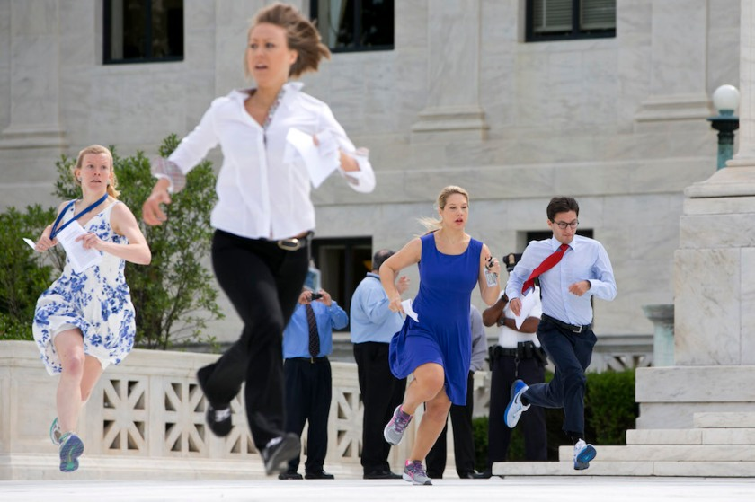 "Interns run across the plaza of the Supreme Court in Washington, Thursday, June 25, 2015, to report the decided opinions to television stations, an event sometimes referred to as the ""running of the interns."" The Supreme Court on Thursday upheld the nationwide tax subsidies under President Barack Obama's health care overhaul, in a ruling that preserves health insurance for millions of Americans. The justices said in a 6-3 ruling that the subsidies that 8.7 million people currently receive to make insurance affordable do not depend on where they live, under the 2010 health care law.  (AP Photo/Jacquelyn Martin)"